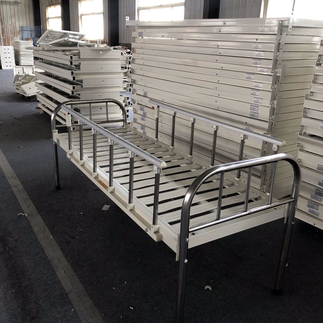 simple hospital bed with rails